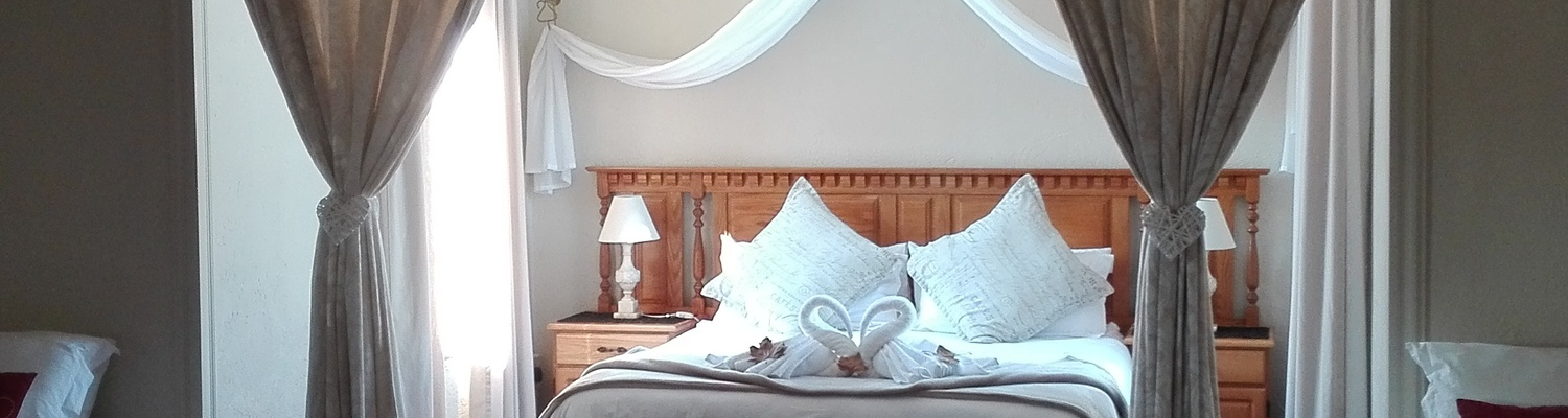 Suite with queen bed for a honeymoon couple, Autumn Breeze Manor and Lodge B&B